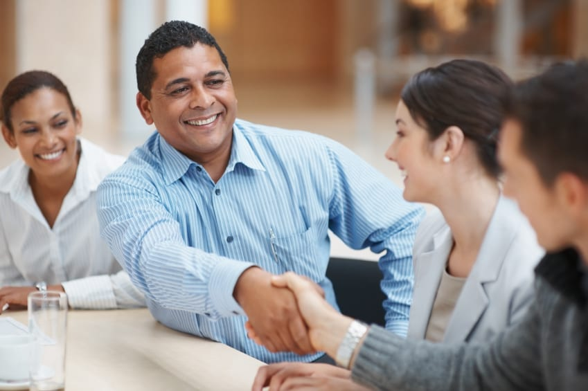 Mature man handshaking with partner after striking a business deal